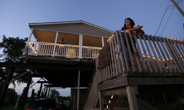 Rocky Morales and Suzanne Guidroz at their home, rebuilt after the previous one was destroyed in Hurricane Katrina, in Delacroix, La., on Aug. 5, 2015. (AP Photo/Gerald Herbert)