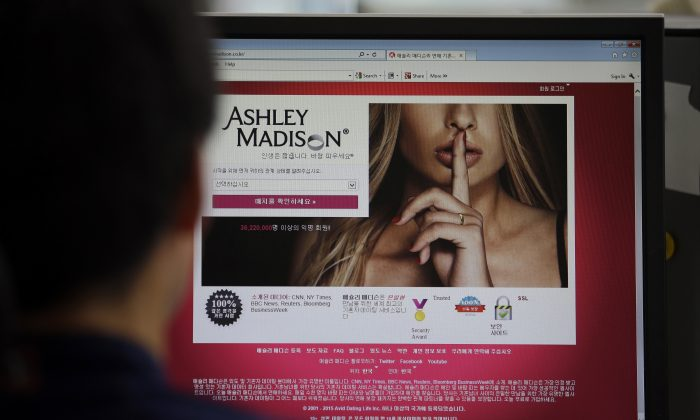A June 10, 2015 photo from files showing Ashley Madison's Korean web site on a computer screen in Seoul, South Korea. (AP Photo/Lee Jin-man)