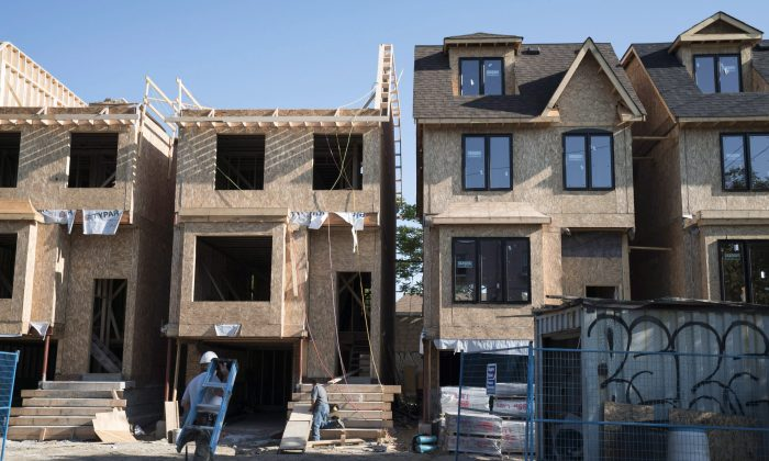 Houses under construction in Toronto on June 26, 2015. (The Canadian Press/Graeme Roy)