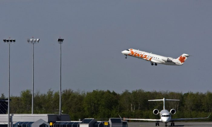 An Air Canada Jazz jet takes off at the Halifax Stanfield International Airport on May 24, 2010. The Canadian Air Transport Security Authority has apologized to a B.C. man who was prevented from boarding a flight because an all-female security crew refused to frisk him. (The Canadian Press/Andrew Vaughan)