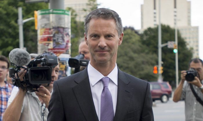Nigel Wright, former Chief of Staff to Prime Minister Stephen Harper, leaves the courthouse on Aug. 19, 2015, following his last day of testimony at the trial of former Conservative Senator Mike Duffy. The politically incendiary information that emerged during Wright's six days on the stand raises a new set of questions for Harper. (The Canadian Press/Justin Tang)