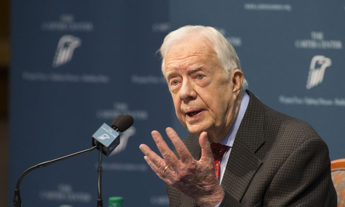 """Former President Jimmy Carter talks about his cancer diagnosis during a news conference at The Carter Center in Atlanta on Thursday, Aug. 20, 2015. Carter announced that his cancer is on four small spots on his brain and he will immediately begin radiation treatment, saying he is """"at ease with whatever comes."""" (AP Photo/Phil Skinner)"""