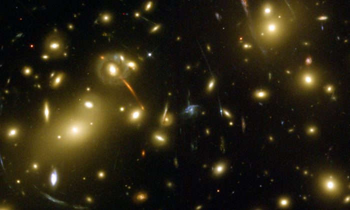 We are a big step closer to tracking down what's hiding in galaxy clusters like Abell 2218. (NASA/ESA via wikipedia)
