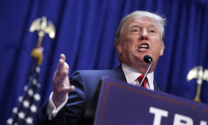 In this June 16, 2015 file photo, Donald Trump announces that he seek the Republican nomination for president, in the lobby of Trump Tower in New York. (AP Photo/Richard Drew)