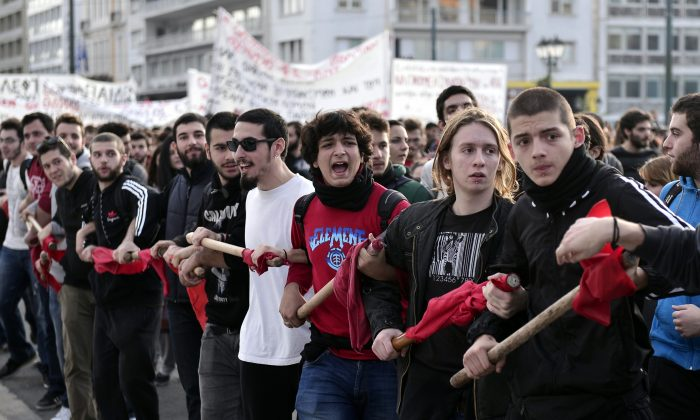 Students protest against educational reform, lack of teachers, and layoffs of administrative staff, in front of the Greek parliament, in Athens, on Nov. 6, 2014. (Louisa Gouliamaki/AFP/Getty Images)