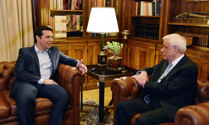Greek Prime Minister Alexis Tsipras (L) talks to the President of the Greek Republic Prokopis Pavlopoulos at the Presidental Mansion in Athens on Aug. 20, 2015. (Louisa Gouliamaki/AFP/Getty Images)
