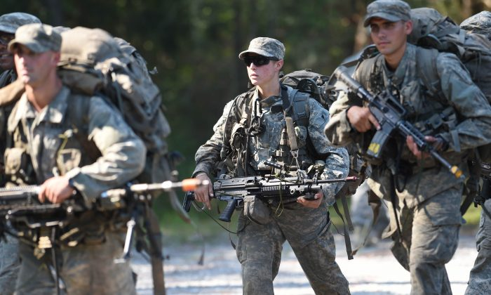 In this photo taken on Aug. 4, 2015, a female Army Ranger marches with her unit during Ranger School at Camp Rudder on Eglin Air Force Base, in Fla.  (Nick Tomecek/Northwest Florida Daily News via AP)