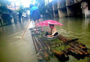 China Reels from Cyclone, Floods, Quake