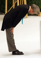 Japanese Prime Minister Junichiro Koizumi bows for the people who died in World War II during a memorial ceremony on August 15 in Tokyo, Japan. (Junko Kimura/Getty Images)