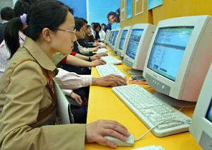 An undated photo shows locals surfing the Internet in a cafe in Shanghai. The Chinese government has created a special Internet police force to shut down sites with certain types of content, such as human rights or politics. (Liu Jin/AFP)