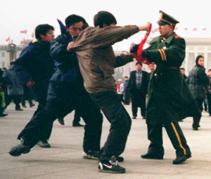 A Falun Gong practitioner is assaulted by police and soldiers in Tiananmen Square in Beijing. (Clearwisdom.net)