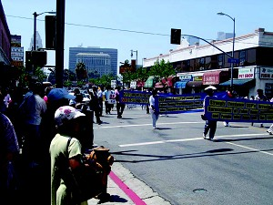 Los Angeles Chinatown vendors, shoppers, residents and tourists stopped what they were doing to watch the 'Quit the Chinese Communist Party' parade contingent that marched through Chinatown three consecutive times. (Epoch Times)