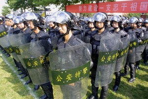 Chinese riot police perform at a demonstration in July. China&#039s President Hu Jintao has urged the police to further maintain stability, at a time where there are an average of  over 200 protests and riots every day. (AFP)