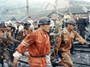 Rescuers rush an injured miner to a hospital after a gas leak at the Zijiang Coal Mine in south China. At least 21 were killed. (China Photos/Getty Images)