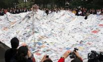 Photo News: World's Biggest Newspaper Dress Displayed in Beijing