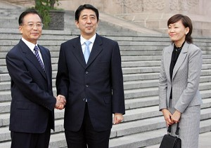 """Shinzo Abe visits China, two weeks after being appointed Prime Minister, with his wife Akie Abe during her """"emissary trip"""" to Beijing (Kazuhiro Nogi/AFP/Getty Images)"""