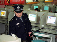Beijing policeman inspecting an Internet bar. (AFP)
