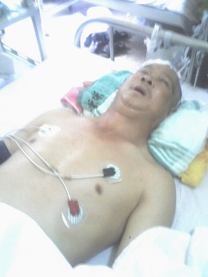 Fu Xiancai in hospital after being assaulted. (The Epoch Times)