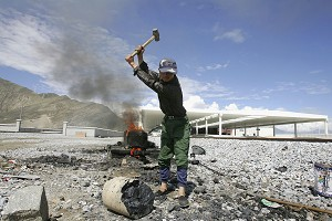 A Tibetan man works at the newly opened Lhasa train station, terminal station of the Qinghai-Tibet Railway Lhasa (Guang Niu/Getty Images)