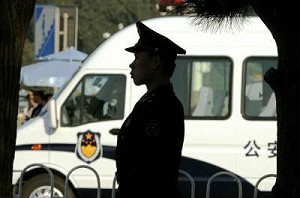 A policeman is sillouetted in Beijing, 16 October 2007. Jiang Jinheng, son of former Chinese Communist Party (CCP) leader Jiang Zeming, has been suspected of taking bribes from a Shanghai tycoon. (Peter Parks/AFP/Getty Images)