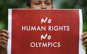 An Indonesian protester holds a protest banner during a protest over Tibet Crisis in front of China's embassy in Jakarta. (Adek Berry/AFP/Getty Images)