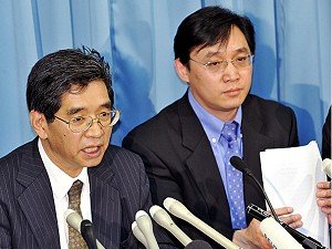 Li Chunfeng (R), head of China's food safety delegation and cabinet officer Shigeru Hotta (L) speak at a press conference, February 6, 2008, after thousands of Japanese have complained of illness, with 10 diagnosed with pesticide poisoning, after eating frozen dumplings which had been made in China and sold in Japan. (Yoshikazu Tsuno/AFP/Getty Images)
