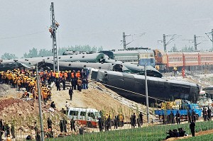 Rescue workers attend the scene of a train collision on April 28, 2008 in Zibo, China (ChinaFotoPress/Getty Images)