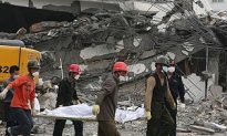China Buries Quake Dead as New Aftershock Hits