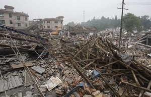 The debris is scattered all over the collapsed township May 17, 2008 in Dujiangyan of Sichuan Province, China. (China Photos/Getty Images)