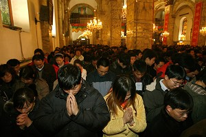 Chinese Catholics pray at a government approved Catholic church. An estimated 10 million 'underground' Chinese Catholics pledge allegiance to the pope, worship in unofficial churches and are often subject to police and government harassment. (Teh Eng Koon/AFP/Getty Images)