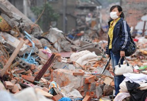 A quake survivor standing amid a massive pile of rubble in southwest China's quake-stricken Sichuan province. The strongest aftershock since the massive May 12 quake jolted China causing residents in some cities to flee buildings in fear of the 6.4 magnitude tremor. (FREDERIC J. BROWN/AFP/Getty Images)