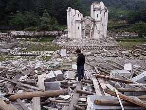 A man salvages what he can from the debris of a destroyed church in Bailu Township in Pengzhou of Sichuan Province, China, on May 31, 2008. (China Photos/Getty Images)