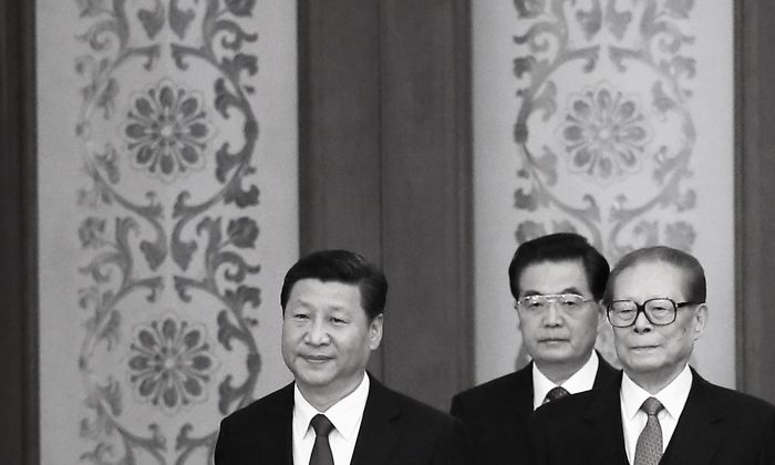 Chinese President Xi Jinping (L) and his predecessors Hu Jintao (C) and Jiang Zemin arrive for the National Day reception marking the 65th anniversary of the founding of the People's Republic of China at The Great Hall Of The People on September 30, 2014 in Beijing, China. (Feng Li/Getty Images)