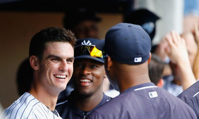 Greg Bird #31 of the New York Yankees celebrates his sixth inning home run against the Minnesota Twins with his team during their game at Yankee Stadium on August 19, 2015 in New York City.  (Al Bello/Getty Images)