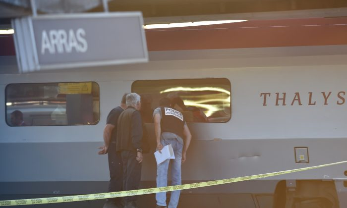 Crime investigators look into the window of a Thalys train of French national railway operator SNCF at the main train station in Arras, northern France, on August 21, 2015. (Philippe Huguen/AFP/Getty Images)