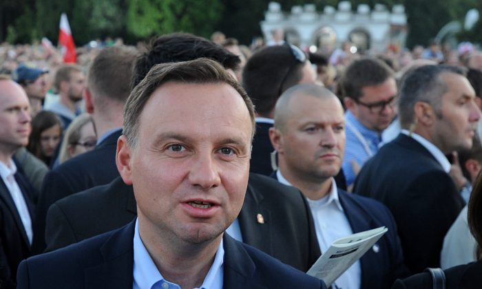 Polish President-elect Andrzej Duda at the Pilsudski Square on the 71st anniversary of the insurgency, in Warsaw, Poland, on Aug. 1, 2015. (AP Photo/Alik Keplicz)