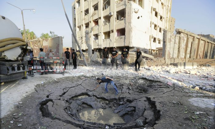 A hole caused by a car bomb in front of the damaged national security building in Cairo, Egypt, on Aug. 20, 2015. (Amr Nabil/AP)
