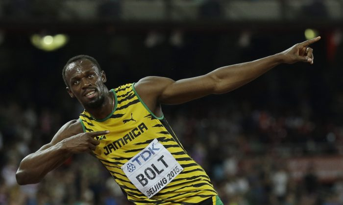 Usain Bolt beat Justin Gatlin by just .01 seconds in the 10-meter dash in what should be a preview of next summer's Olympics. (AP Photo/David J. Phillip)