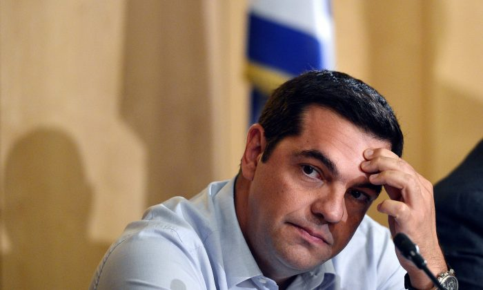 Greek PM Alexis Tsipras in a press conference at the Greek Ministry of Infrastructure, Transport, and Networks in Athens on Aug. 12, 2015. (Louisa Gouliamaki/AFP/Getty Images)