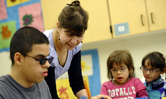 Volunteer art teacher Bojana Coklyat, teaches blind students at the School for the Blind in Jersey City, N.J., on April 23, 2012. (Timothy A. Clary/AFP/GettyImages)