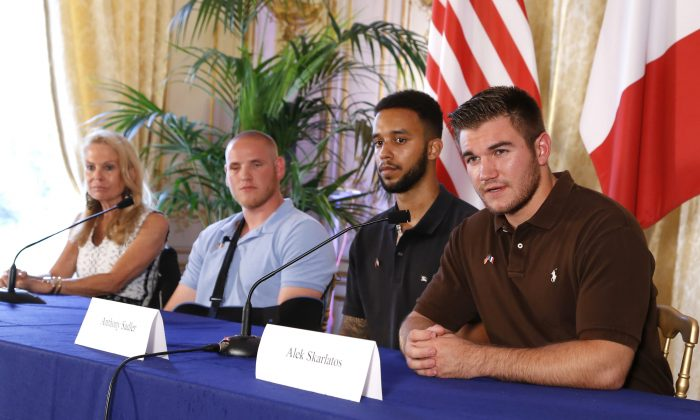 (From L) US ambassador to France Jane Hartley, off-duty US servicemen Spencer Stone, Anthony Sadler and Alek Skarlatos attend a press conference at the US embassy in Paris on August 23, 2015. (Thomas Samson/AFP/Getty Images)