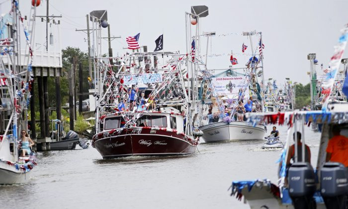 Boats line up in Bayou Terre aux Boeufs during the blessing of the fleet in Delacroix, La., Saturday, Aug. 8, 2015. It was the first blessing of the fleet since the coastal fishing and shrimping community was devastated by Hurricane Katrina a decade ago. (AP Photo/Gerald Herbert)
