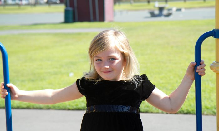 Amry Errico, 5, at Riverside Park in Port Jervis on Aug. 23, 2015. Errico is going to start school at the Hamilton Bicentennial Elementary school in Deerpark on Sept. 3, 2015. (Holly Kellum/Epoch Times)