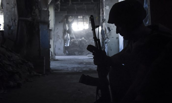 A Russia-backed rebel prepares ammunition at his position inside Donetsk airport, Ukraine, on June 9, 2015. (Mstyslav Chernov/AP)