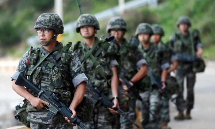 South Korean marines patrol along on Yeonpyeong island, South Korea, on Aug. 23, 2015. (Yun Tae-hyun/Yonhap via AP)