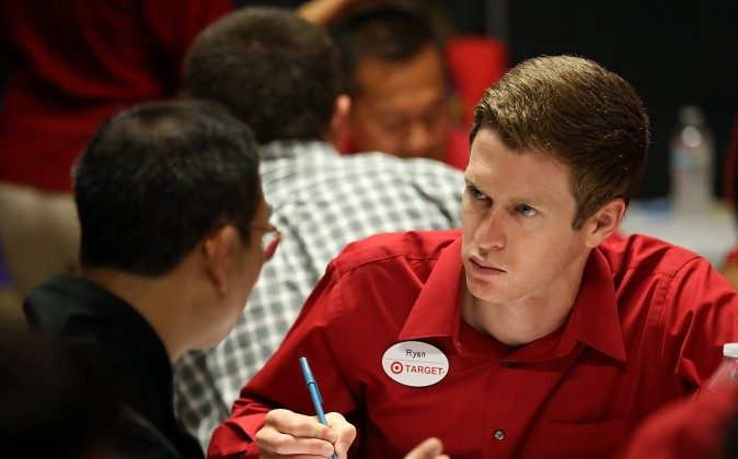 A Target employee interviews a job seeker during a job fair at a Target retail store in San Francisco on Aug. 15, 2013. (Justin Sullivan/Getty Images)