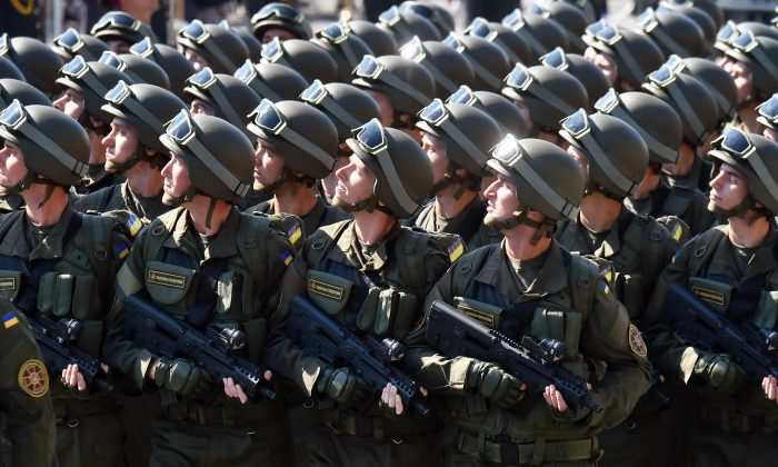 Ukrainian servicemen take part in a military parade in Kiev on Aug. 24, 2015, to celebrate Independence Day, 24 years since Ukraine gained independence from the Soviet Union. Ukrainian President Petro Poroshenko accused Russia of this week sending three military convoys over the border into the separatist-controlled east with a total of up to 500 tanks, 400 artillery systems and up to 950 military armored vehicles to pro-Russian rebels, although he did not specify the time period for these deliveries. (Sergei Supinsky/AFP/Getty Images)