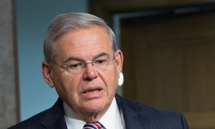 In the photo taken July 23, 2015, Sen. Bob Menendez, D-N.J. is seen on Capitol Hill, in Washington. Florida eye doctor Dr. Salomon Melgen,  linked to Menendez in a corruption case is seeking changes in his bond conditions in an unrelated Medicare fraud prosecution. (AP Photo/Andrew Harnik)