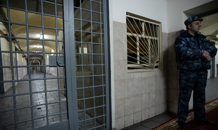 A guard stands in a passage of the notorious Butyrka remand prison in Moscow, on December 4, 2013.  Kirill Kudryavstev /AFP/Getty Images)