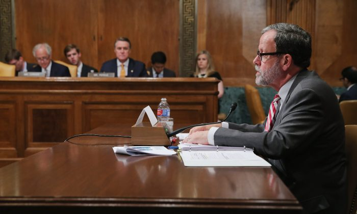 In this file photo, congressional Budget Office Director Keith Hall (R) testifies before the Senate Budget Committee in the Dirksen Senate Office Building on Capitol Hill June 17, 2015 in Washington, DC. (Chip Somodevilla/Getty Images)